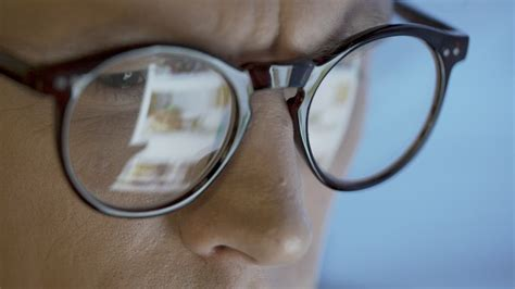 Reflection of screen information on glasses - Free Stock Video